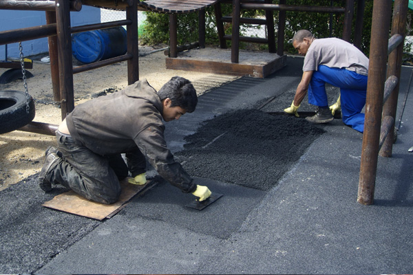 First We lay a thick crumb of rubber for the base layer just to create a compact ground.